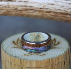 Antler Lined Wedding Ring with Paua Shell & Whiskey Barrel Inlays. Handcrafted by Staghead Designs.