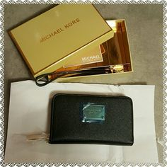 MICHAEL KORS MULTI FUNCTION WALLET NWT MICHAEL KORS MULTI FUNCTION WALLET. FITS IPHONE 4, 5, 5S, 5C, AND 6. 3 CARD SLOTS. ZIP AROUND CLOSURE. GIFT BOX INCLUDED. BLACK PEBBLED LEATHER.  THIS HAS ONLY BEEN TAKEN OUT OF THE WRAPPER TO TAKE PICTURES.   6 1/2 X 4 1/2 X 1  SAME OR NEXT DAY SHIPPING.  REASONABLE OFFERS ACCEPTED! MICHAEL Michael Kors Bags Wallets