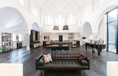 A massive London Church transformed into a home //  This modern and special property is located in London England and impresses by a very stylish interior and its spaciousness. The sacred property features a living space of almost 600m a fitness room...