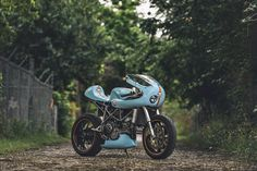 With a little help from my friends. Jon Ball's Gulf Racing Ducati 748 via returnofthecaferacers.com