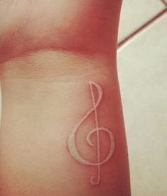 White ink tattoos are kinda awesome... @Stacy Patterson  music notes always make me think of you! :)
