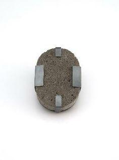 Brooch 2012-2 by Ute Eitzenhoefer - Germany          Brooch 2012-2  5,5 x 7,5 x 2,5cm  pumice stone, silver 925/000 oxidized, stainless  steel
