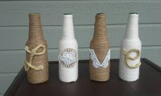 Set of 4 glass beer bottles wrapped in twine, rope, and jute spelling the word LOVE. The words are made from ribbon, lace, jute, and pearls. These make a great wedding gift or an anniversary gift for the one you love. If you would like a different 4 letter word please specify at the notes section at checkout. If you need a longer or shorter word, message me and I will create a listing for you. If you would like to add a color to this design, please include your color in the notes section at…