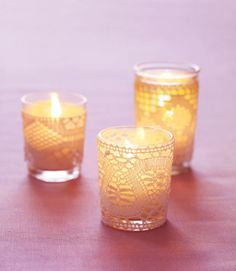 If you're looking to give a sweet, whimsical gift, then try making your own candleholders. Buy some lacy trim from any fabric store, then cut and glue into a candleholder of any size. Give your guests a nice, romantic gift that they can use to help decorate their home. Click through for a tutorial and more bridal shower favor ideas.