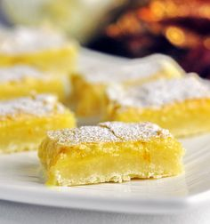 Super Easy Orange Ginger Bars - a close cousin to our very popular, easy lemon bar recipe, this cookie bar is a lusciously refreshing choice for the Holidays.