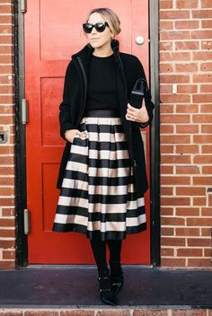 fall / winter - street style - street chic style - fall outfits - winter outfits - party outfits - night out outfits - holiday outfits - black turtleneck top + black coat + black and white stripe midi skirt + black clutch + black tights + black ankle strap heels + black sunglasses