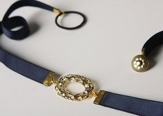 """Navy blue Elastic Waist Belt - Gold Vintage Style Buckle - Blue Belt - Party Belt - Bridesmaids Belt - Cocktail Dress Belt - Skinny Belt  Navy- blue elastic waist belt with 24K gold vintage inspired center element. The belt closes through a vintage button and a loop in the back.  This belt will totally upgrade your bridal/ bridesmaid or every day look- adding that vintage romantic touch!  belt width - 13 mm / 0.5""""  Extent:  XS-S: 64 cm / 25"""" M-L: 70 cm / 27.3"""" XL: 76cm / 29.6"""" $28"""