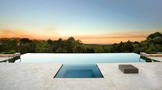 Contemporary symmetrical pool with infinity edge and an amazing view.Pinned to Pool Design by Darin Bradbury.