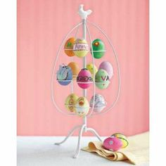 Original Easter decoration Ostereir brightly painted on metal stand