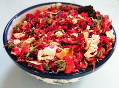 A bowl of scarlet Sweetheart potpourri I made for Valentines day with dried rose buds and petals.