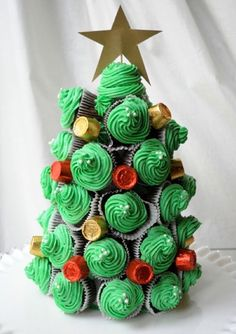 Create a cupcake Christmas tree centerpiece for your dessert table by arranging cupcakes on cone-shaped Styrofoam. Fill any gaps with candy pieces like holiday-colored Rolos. Get the recipe at Teaspoon. Christmas Cupcake Cake, Christmas Tree Food, Holiday Cupcakes, How To Make Christmas Tree, Alternative Christmas Tree, Christmas Goodies, Christmas Treats, All Things Christmas, Christmas Diy