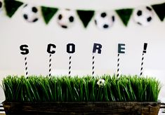 Faux grass and mini soccer balls will make your guests feel like they're in the middle of the pitch during your World Cup viewing party.