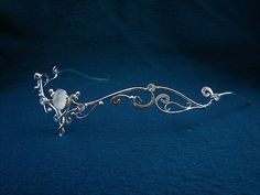 The Moonlight circlet is made in Sterling Silver with a white moonstone and clear Swarovski crystals. Beautiful medieval accessory for Renaissance Faires.