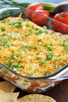 7 Layer Bean Dip is a quick & easy recipe for the most popular appetizer EVER! It's perfect to bring to a party or to serve on game day!