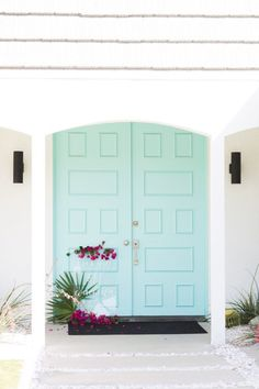 How cute and clean do these mint blue doors look?! It looks great with the white house for a small pop.