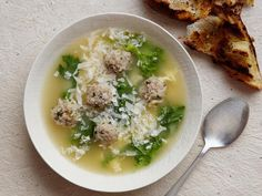Italian Wedding Soup  Don't bother with the egg and cheese. It's great without them. I used some thawed and drained frozen spinach and it was a great substitute!