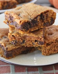 Pumpkin Chocolate Chip Bars Recipe on twopeasandtheirpod.com Super easy to make and everyone LOVES these bars!