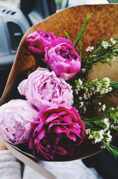Pink peonies wrapped up for giving