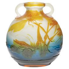 Galle Acid Etched Cameo Glass Vase  Circa 1900  Of flattened globular form, with applied C-form handles, in dark amber, blue and frosted colorless glass, decorated with dragonflies and pond lilies, signed Galle. Height 7 3/4 inches.