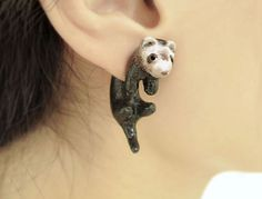 This is a pair of adorable ferret two-part earrings. They fit perfectly on your lobes. These earrings can be a great gift for animal lovers! Extremely unique!  Each ferret is about an 3.3cm long (including the tail) and comfortable for all day wear. This pair of earring stud is made out of polymer clay, painted with acrylic paint and finished with a glaze. Earring backs are surgical steel earring posts. The earring post is embedded in the base for better durability.  Please note that these…