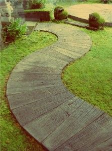 love this — faux teakwood pavers (concrete)...could be done on front walkway to tie in back yard (if I do wood pavers in the back)