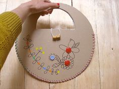 Here's a pair of DIY laced recycled cardboard bags to carry your summer crafts.