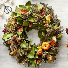 Bring home the beauty of harvest fields and woodlands with our imaginative autumn wreath. Crafted for us on a Northern California family-owned farm, this eye-catching decoration highlights the season's bounty with faux pumpkins and berries, artfully hand arranged on a lush ring of dried sweet annie, safflower, tansy, preserved leaves and fresh salal. For decorative use only. Hang indoors or in a sheltered outdoor area protected from weather. Easy Fall Wreaths, Wreaths And Garlands, Door Wreaths, Halloween Wreaths, Winter Wreaths, Outdoor Halloween, Halloween Projects, Halloween 2020, Roman Shade Tutorial
