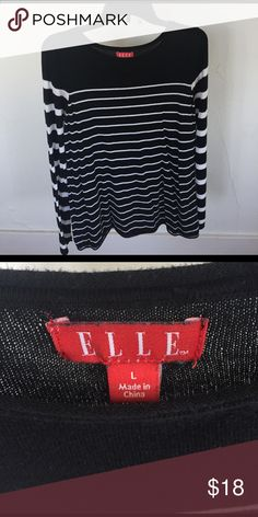 Elle black and white striped long sleeve Love the variation of stripe sizes on this long sleeve top! It's a lightweight and soft material and is perfect for this time of year as we transition from Winter to Spring! *please note that there is a small hole in the front* Elle Tops Tees - Long Sleeve