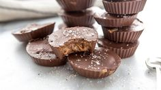 Mix up a splendidly simple batch of paleo-approved sweets. Raw almond butter, sweetened with raw honey and inside good-for-you chocolate, topped with sea salt.