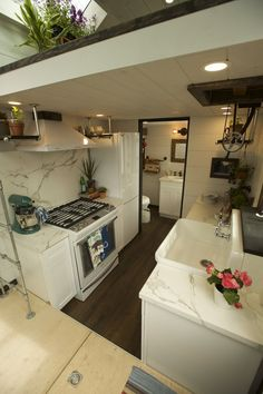 This is a 173 sq. tiny house on wheels with two lofts and floor storage and you are welcome to come check it out inside! Tiny Spaces, Loft Spaces, Lofts, Apartment Size Refrigerator, Bunk Bed Designs, Outdoor Kitchen Design, Kitchen Designs, Farmhouse Style Kitchen, Tiny House Living