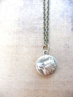 Wolf pendant made from mold of vintage button by DreamofaDream