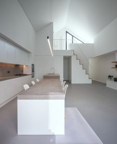 Internally, the house features a double-height living space that extends all the way up to the exposed pitched ceiling.