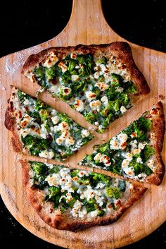 Spinoccoli Pizza -  Goat cheese with broccoli, spinach, mozzarella cheese and light alfredo-like sauce.