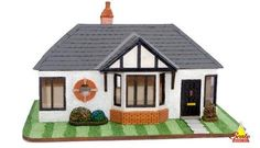 1940s ACORN BUNGALOW Acorn Bungalow is based on the typical suburban residences of the 1940's with trademarks of the stockbroker tudor design. The layout would be ideal for a miniature couple; consisting of entrance, living room, rear garden-facing kitchen, corridor leading to bathroom Miniature Houses, Shopping Hacks, Acorn, Scale Models, Dollhouse Miniatures, Bungalow, Gazebo, Lanterns, Entrance