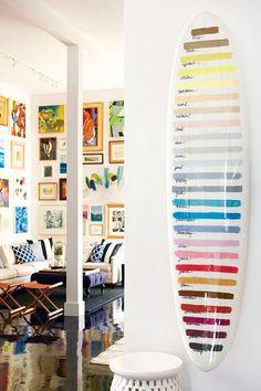 A surfboard shaped by Michel Junod of Santa Cruz shows a range of custom paints-many originating as wall colors Serena  Dugan hand-mixed during catalog shoots. PHOTO: Serena & Lily.