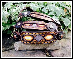Custom halter, beaded inlay on cheeks and noseband. Antique copper conchos/rosettes.