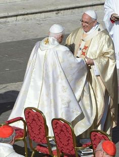 Pope Francis & Pope Benedict greet each other before th canonizations of Pope John 23 & Pope John Paul II