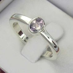 taaffeite ring - rarest gemstone ring in the world - light violet purple color. $349.00, via Etsy.