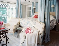 canopy bed and two chairs in master