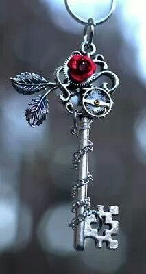 Beautiful charm.  Antique key with red rose.  <3