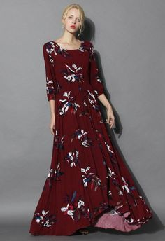 Take your lyrical imagery off the page and onto the scene with this wine red maxi dress. Sway with a stupendous hemline, patterned with colored wildflowers in a daker hue, and detailed with ruffles from waist, this maxi dress embodies imaginative beauty.