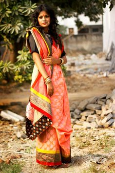 CR1311235 - Peatch color saree with Chanderi, Banaras pleats & plane georgette pallla. Copper zary boreder with red & yellow stripes. Facing in chocklate brown block print.