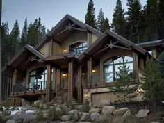 A house of glass and wood in the mountains