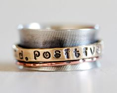 """Says """"positive mind. positive life."""" which is something I tell my husband CONSTANTLY. My exact words r """"if u want to be happy, u will be. But, if all u think is negative, u will be that instead. It's a great power u have & only u can control ur outlook!"""" I NEED THIS RING... IT'S MY MANTRA!"""