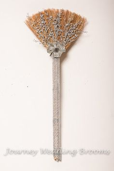 @Gwen Shay - if you are jumping the broom....Diamond Life Wedding Broom. $54.95, via Etsy or you can make it!