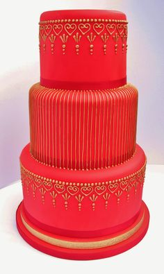 This cake is the first in a new range of Asian wedding cakes that Bollycakes have designed for 2014.  Expect lots of metallic detail on a vibrant yet simple backdrop.  This cake would be perfect for a Valentines wedding! www.bollycakes.com #asianweddingcakes #indianweddingcakes