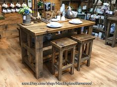 Rustic and Charming Kitchen Island with matching bar stools.  This Chunky Style Rustic island features a full 2 inch thick top with bar seating on one side and 2 storage shelves on the other.     Custom Orders Welcome!! #newenglandbarnwood #shopcrompton #rusticdecor #kitchenisland #kitchenislands #kitchenislanddesign #kitchenislanddecor #farmhousetable #farmhousetables