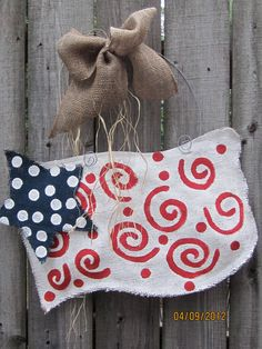 Burlap USA Flag Red, White and Blue Burlap Door Hangers American Flag. $28.00, via Etsy.