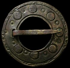 "Huge Viking bronze brooch, c. 8th-9th century AD. Comprised of a large, flat disc with notch and pin. Round incised details around the front surface. Great copper-green patina. Big 43 mm (1 5/8"") diameter. Found in Latvia."