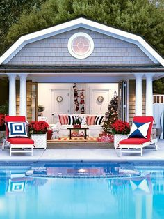 This nautical pool house in Tiburon, California, gets a holiday makeover with a sailboat-themed Christmas tree, hand-knitted stockings, and fresh red poinsettias.